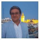 Enric Millo. Secretario General de Acción Exterior de la Junta de Andalucía. Foto de Millo con la Giralda al fondo